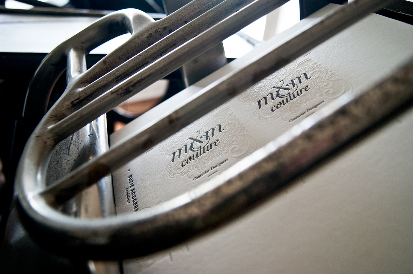 Detail of Creative Emporium designed MXM Couture business cards on printing press with new branding in Yesterday Creative Letterpress Studio