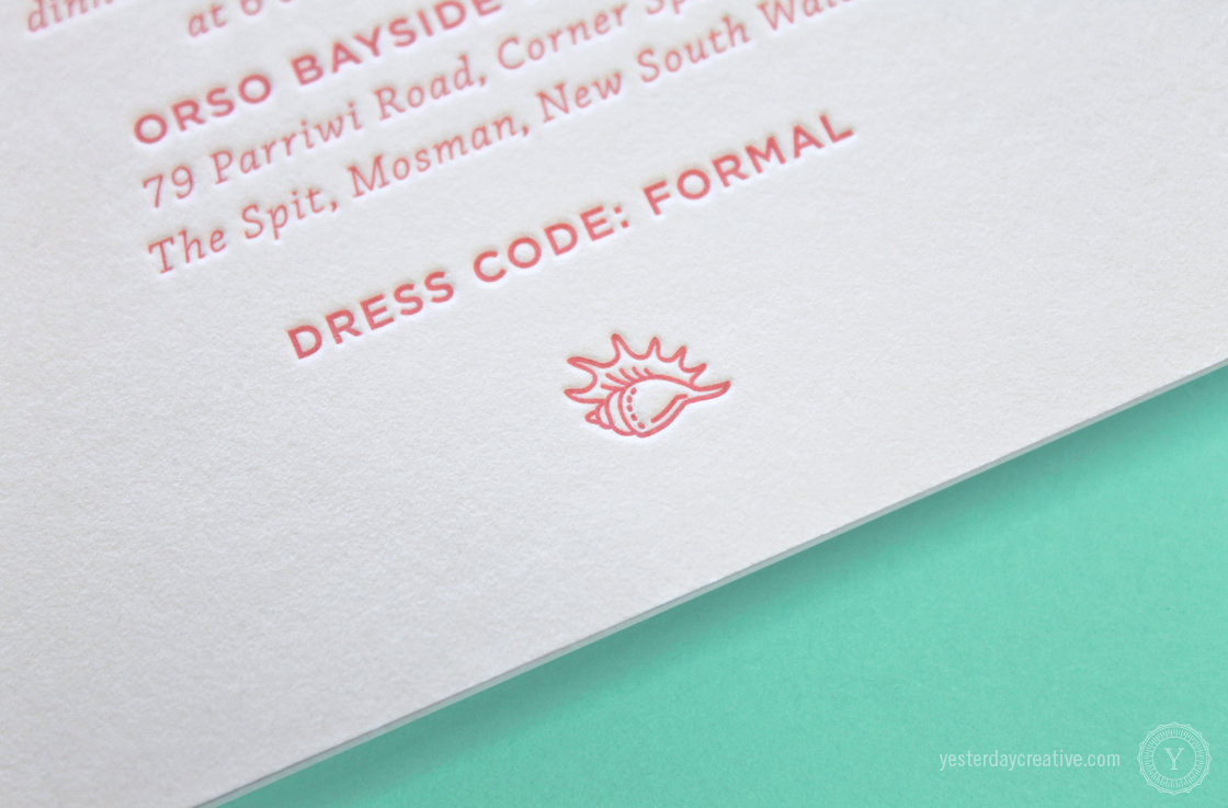 Mark & Nicole's seaside themed Letterpress Wedding invitation printed in coral pink on white cotton paper featuring a conch shell.